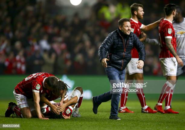 Bristol City players celebrate their victory as fans invade the pitch after the English League Cup quarterfinal football match between Bristol City...