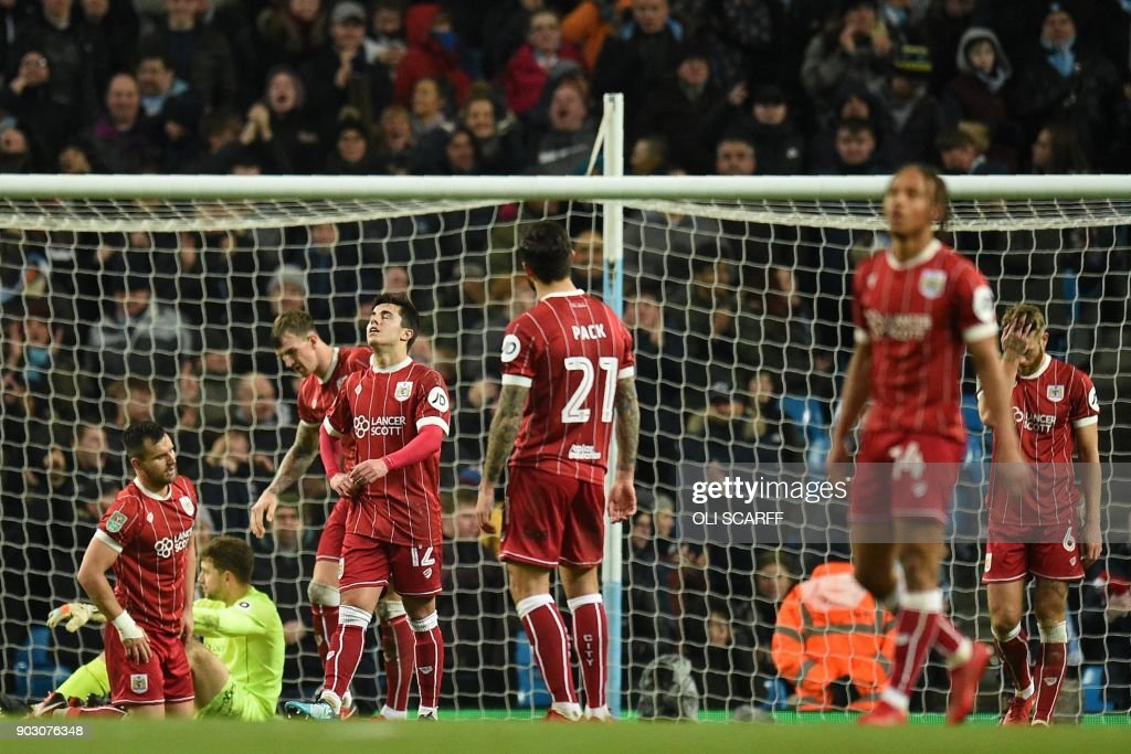 Bristol City players react after conceding a late goal during the English League Cup semi-final first leg football match between Manchester City and Bristol City at the Etihad Stadium in Manchester, north west England, on January 9, 2018. Manchester City won the game 2-1. / AFP PHOTO / Oli SCARFF / RESTRICTED TO EDITORIAL USE. No use with unauthorized audio, video, data, fixture lists, club/league logos or 'live' services. Online in-match use limited to 75 images, no video emulation. No use in betting, games or single club/league/player publications. /
