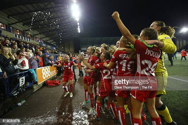 Bristol City Women celebrate securing promotion after beating Everton Ladies during the WSL 2 match between Everton Ladies and Bristol City Women at...