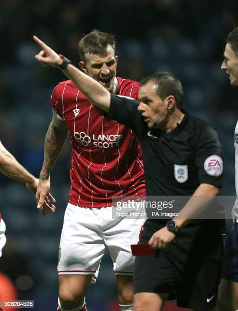 Bristol City's Aden Flint is sent off by referee Geoff Eltringham during the Sky Bet Championship match at Deepdale Preston