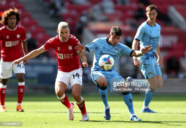 Bristol City's Andreas Weimann and Coventry City's Gustavo Hamer battle for the ball during the Sky Bet Championship match at Ashton Gate, Bristol.