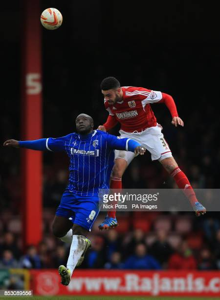 Bristol City's Derrick Williams heads ball away from Gillingham's Adebayo Akinfenwa during the Sky Bet League One match at Ashton Gate Bristol