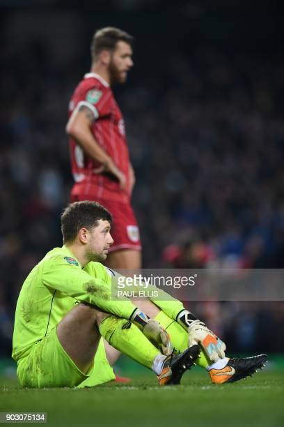 Bristol City's English goalkeeper Frank Fielding reacts after they concede a late goal during the English League Cup semifinal first leg football...