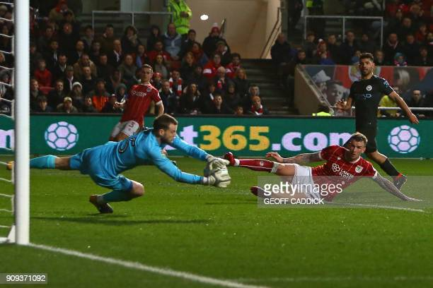 Bristol City's English goalkeeper Luke Steele makes a save during the English League Cup semifinal second leg football match between Bristol City and...