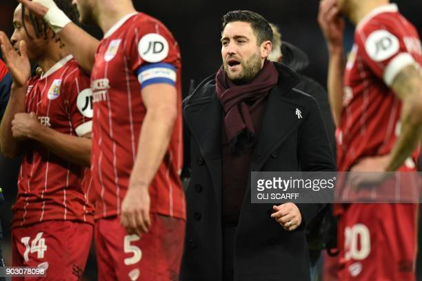 Bristol City's English manager Lee Johnson and Bristol City's players go to their supporters after the English League Cup semifinal first leg...