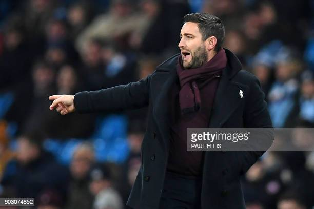 Bristol City's English manager Lee Johnson gestures on the touchline during the English League Cup semifinal first leg football match between...