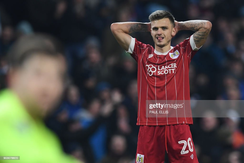 Bristol City's English midfielder Jamie Paterson reacts after they concede a late goal during the English League Cup semi-final first leg football match between Manchester City and Bristol City at the Etihad Stadium in Manchester, north west England, on January 9, 2018. Manchester City won the game 2-1. / AFP PHOTO / Paul ELLIS / RESTRICTED TO EDITORIAL USE. No use with unauthorized audio, video, data, fixture lists, club/league logos or 'live' services. Online in-match use limited to 75 images, no video emulation. No use in betting, games or single club/league/player publications. /