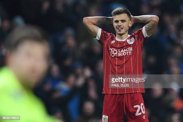 Bristol City's English midfielder Jamie Paterson reacts after they concede a late goal during the English League Cup semifinal first leg football...