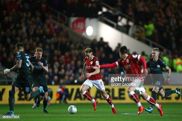 Bristol City's English midfielder Josh Brownhill runs with the ball during the English League Cup semifinal second leg football match between Bristol...
