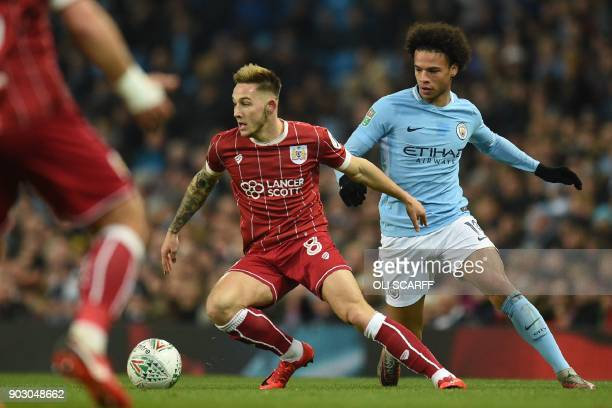 Bristol City's English midfielder Josh Brownhill vies with Manchester City's German midfielder Leroy Sane during the English League Cup semifinal...