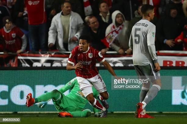 Bristol City's English midfielder Korey Smith celebrates scoring the team's second goal past Manchester United's Argentinian goalkeeper Sergio Romero...