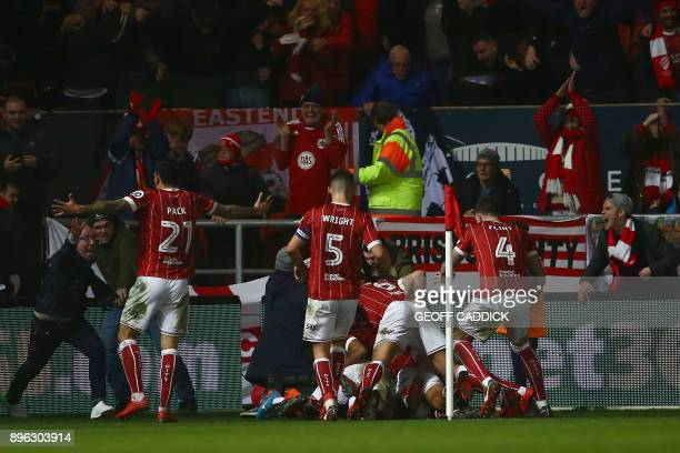 Bristol City's English midfielder Korey Smith celebrates with teammates scoring the second goal during the English League Cup quarterfinal football...