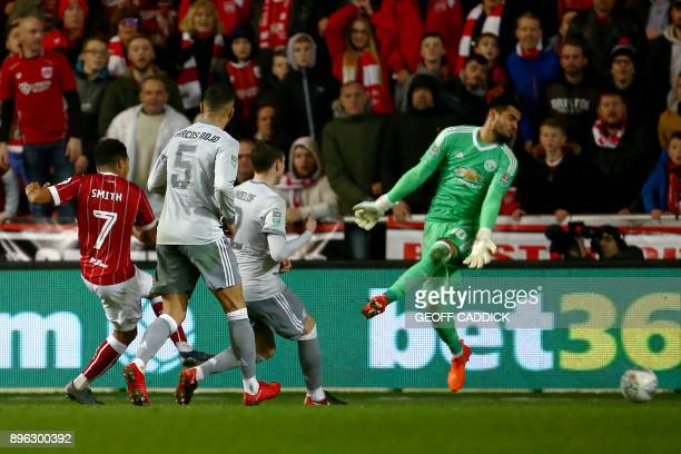 Bristol City's English midfielder Korey Smith scores the team's second goal past Manchester United's Argentinian goalkeeper Sergio Romero during the...