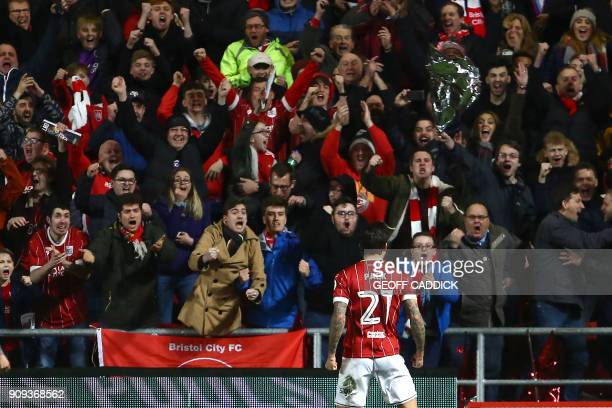 Bristol City's English midfielder Marlon Pack celebrates scoring their first goal with supporters during the English League Cup semifinal second leg...