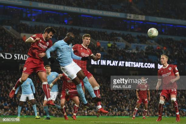 Bristol City's English midfielder Marlon Pack heads the ball clear during the English League Cup semifinal first leg football match between...