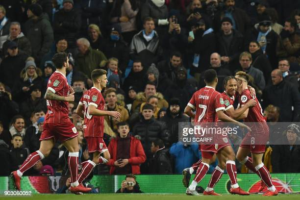 Bristol City's English striker Bobby Reid celebrates with teammates after scoring the opening goal from the penalty spot during the English League...