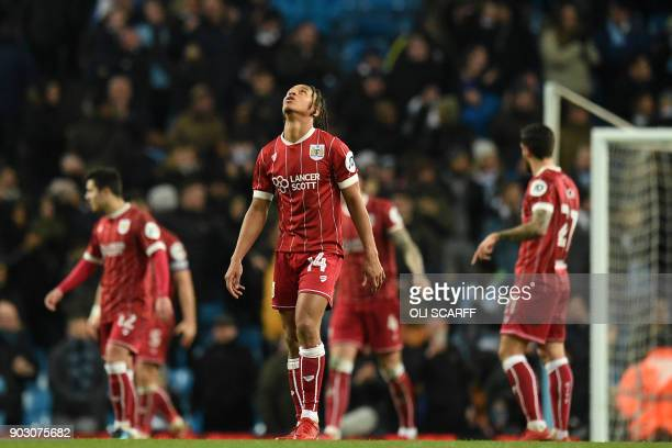 Bristol City's English striker Bobby Reid reacts after they concede a late goal during the English League Cup semifinal first leg football match...
