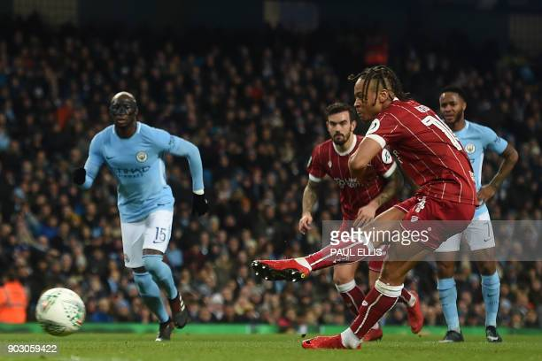 Bristol City's English striker Bobby Reid scores the opening goal from the penalty spot during the English League Cup semifinal first leg football...