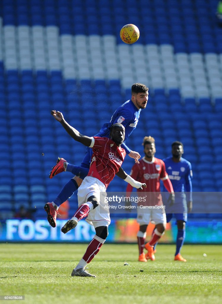 Bristol City's Famara Diedhiou vies for possession with Cardiff City's Callum Paterson during the Sky Bet Championship match between Cardiff City and Bristol City at Cardiff City Stadium on February 25, 2018 in Cardiff, Wales.