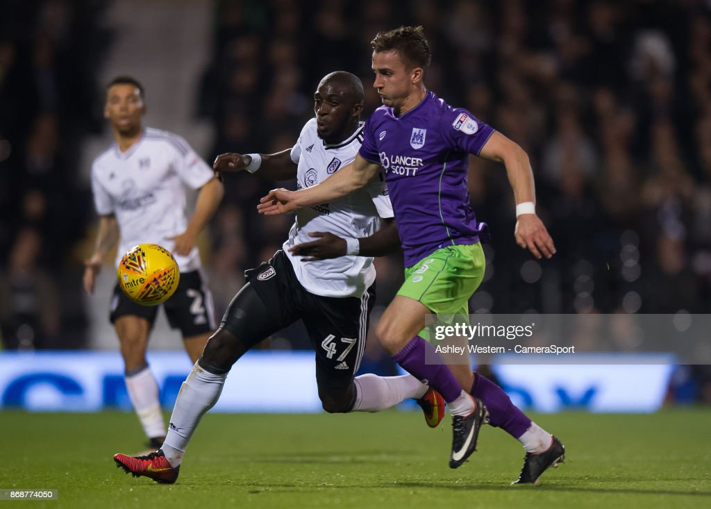 Bristol City's Joe Bryan holds off the challenge from Fulham's Aboubakar Kamara during the Sky Bet Championship match between Fulham and Bristol City at Craven Cottage on October 31, 2017 in London, England.