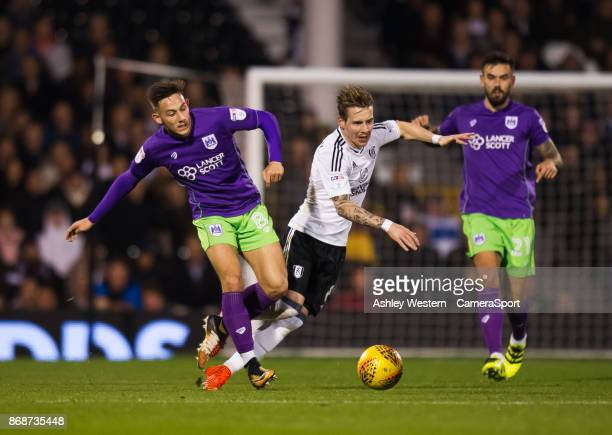 Bristol City's Josh Brownhill battles for possession with Fulham's Stefan Johansen during the Sky Bet Championship match between Fulham and Bristol...