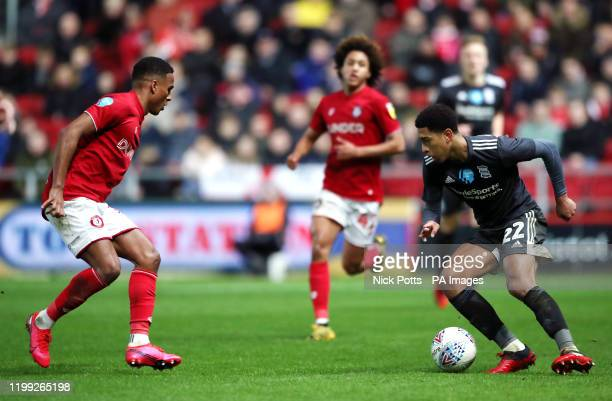 Bristol City's Korey Smith and Birmingham City's Jude Bellingham battle for the ball during the Sky Bet Championship match at Ashton Gate Bristol