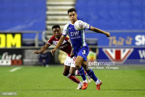 Bristol City's Niclas Eliasson and Wigan Athletic's Antonee Robinson battle for the ball during the Sky Bet Championship match at the DW Stadium Wigan