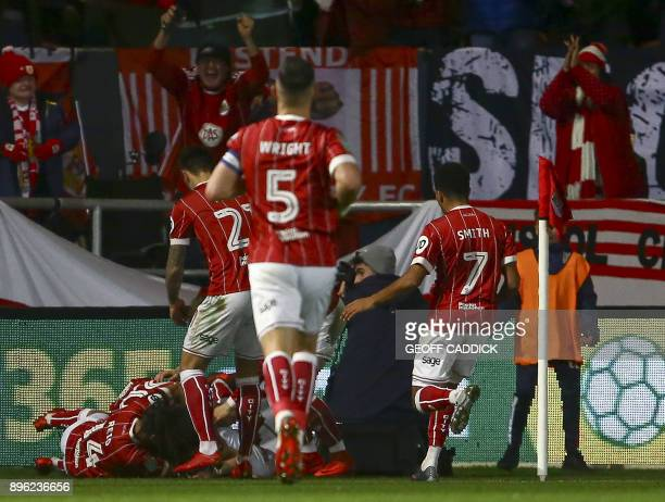 Bristol City's Scottish defender Joe Bryan celebrates with teammates scoring the team's first goal during the English League Cup quarterfinal...