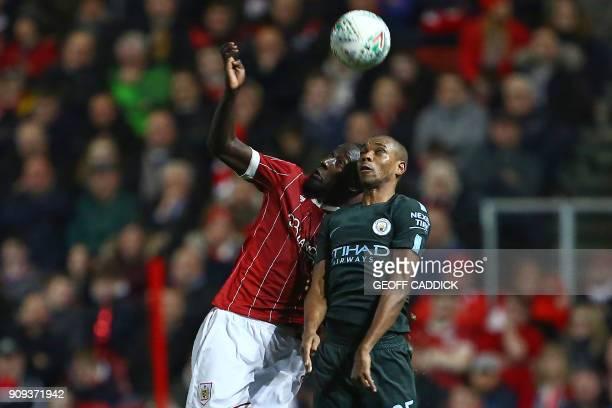 Bristol City's Senegalese striker Famara Diedhiou vies with Manchester City's Brazilian midfielder Fernandinho during the English League Cup...