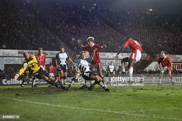 Bristol City's Wayne Allison scores against Liverpool