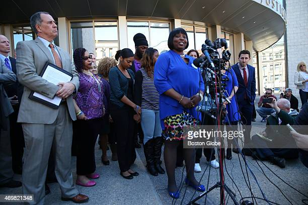 Bristol County District Attorney Thomas Quinn left listens as Ursula Ward the mother of Odin Lloyd speaks to the media after Aaron Hernandez was...