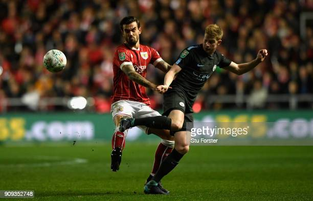 Bristol defender Aden Flint challenges Kevin De Bruyne during the Carabao Cup SemiFinal Second Leg match between Bristol City and Manchester City at...