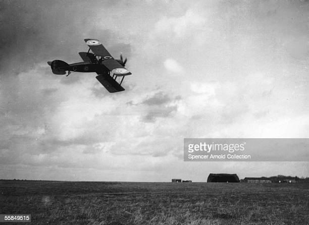 A Bristol fighter of 22 Squadron flies over Vert Galand aerodrome France on the inauguration day of the British Royal Air Force 1st April 1918 The...