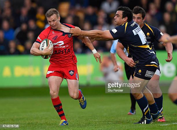 Bristol player Dwayne Peel is tackled by Aagustin Creevy during the Greene King IPA Championship final second leg match between Worcester Warriors...
