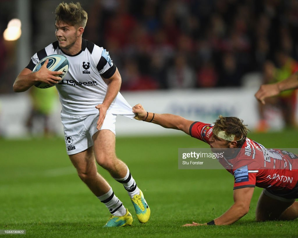 Bristol player Harry Randall breaks the challenge of Gloucester player Callum Braley during the Gallagher Premiership Rugby match between Gloucester Rugby and Bristol Bears at Kingsholm Stadium on September 14, 2018 in Gloucester, United Kingdom.