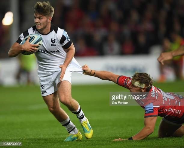 Bristol player Harry Randall breaks the challenge of Gloucester player Callum Braley during the Gallagher Premiership Rugby match between Gloucester...