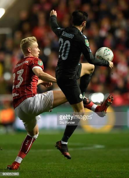 Bristol player Hordur Magnusson challenges Bernardo Silva during the Carabao Cup SemiFinal Second Leg match between Bristol City and Manchester City...