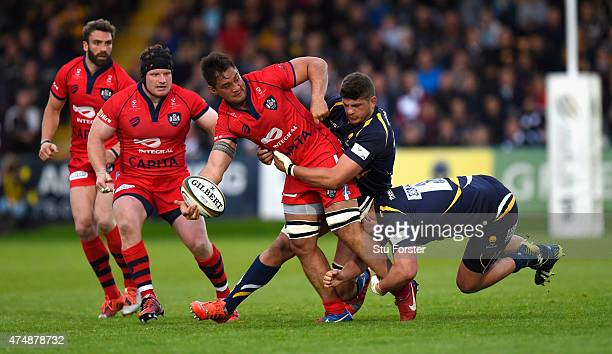 Bristol player Jack Lam is tackled by Mike Williams and Nick Schonert during the Greene King IPA Championship final second leg match between...