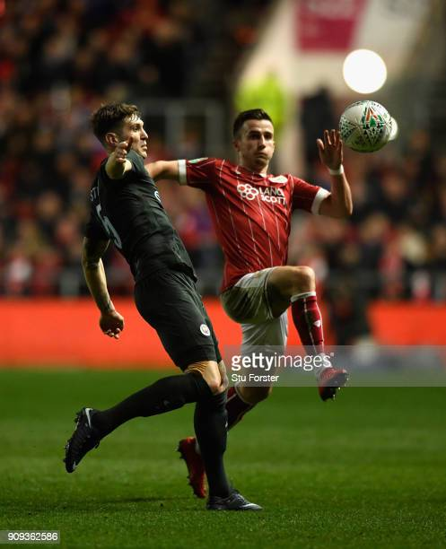 Bristol player Joe Bryan challenges John Stones of Manchester City during the Carabao Cup SemiFinal Second Leg match between Bristol City and...