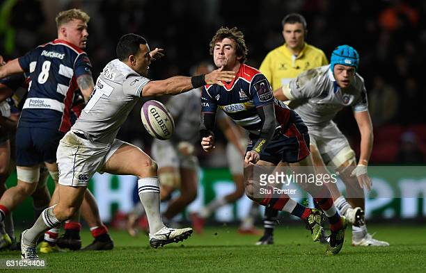 Bristol player Rhodri Williams releases the ball despite the attentions of Kahn Fotuali'i during the European Rugby Challenge Cup match between...