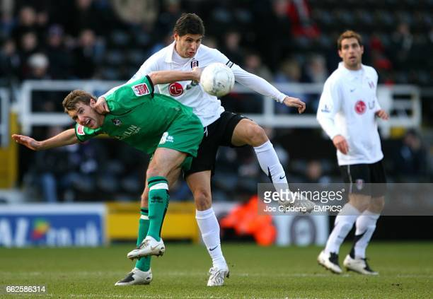 Bristol Rovers' Andrew Williams and Fulham's Dejan Stefanovic battle for the ball