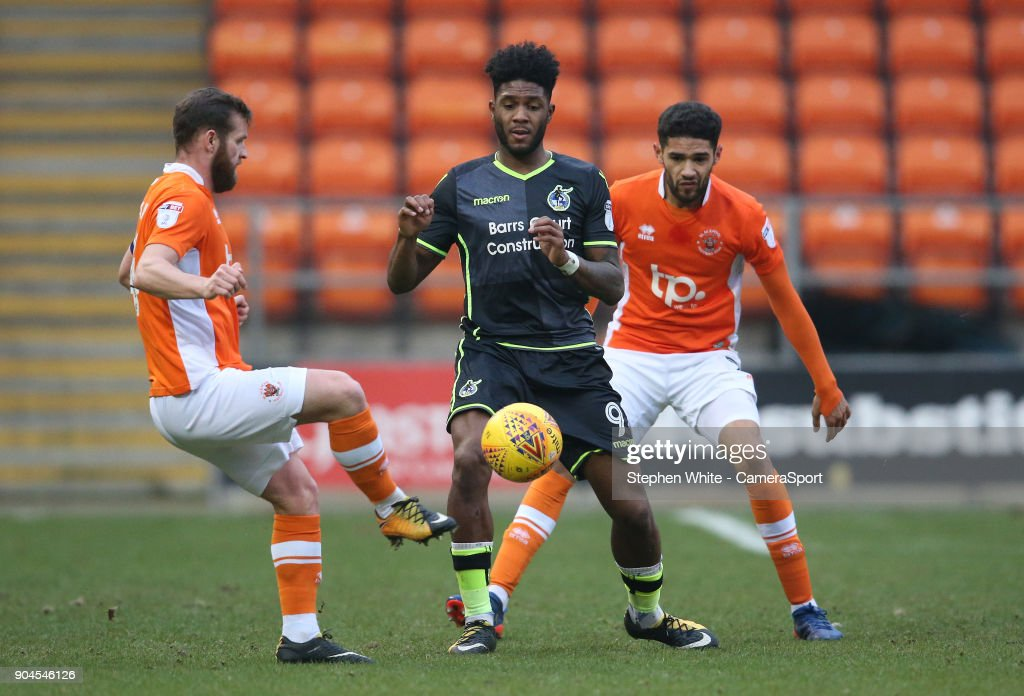 Bristol Rovers' Ellis Harrison battles with Blackpool's Jimmy Ryan (left) and Kelvin Mellor (right) during the Sky Bet League One match between Blackpool and Bristol Rovers at Bloomfield Road on January 13, 2018 in Blackpool, England.