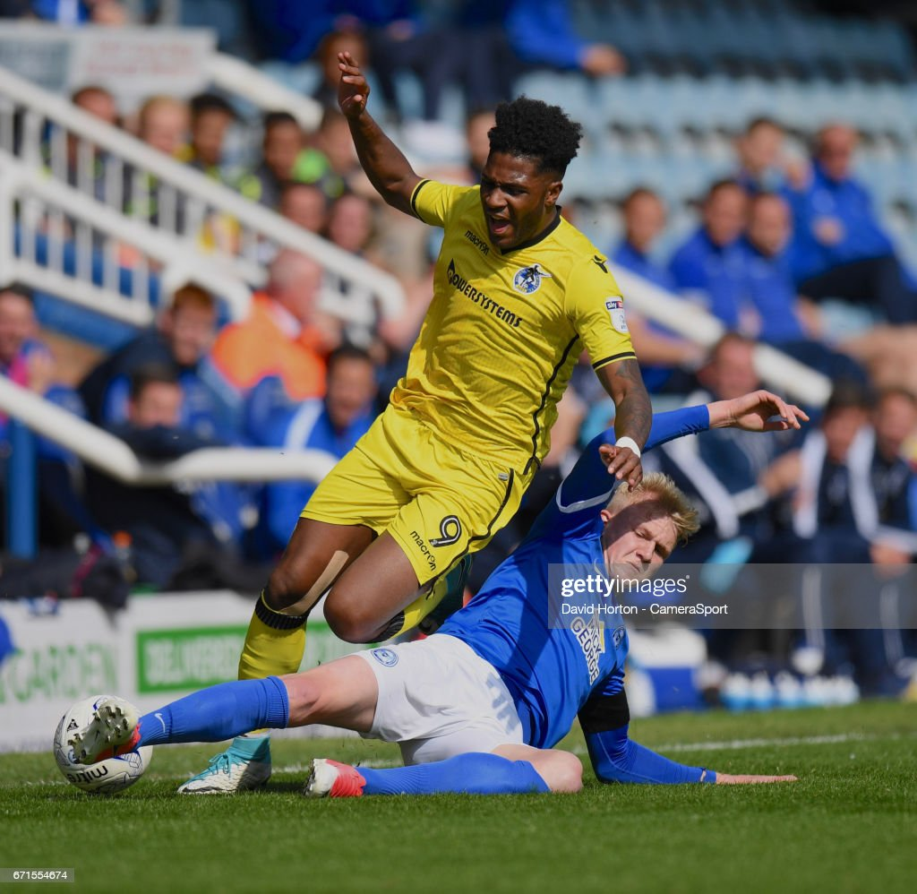Bristol Rovers' Ellis Harrison (L) is tackled by Peterborough United's Lewis Freestone (R) during the Sky Bet League One match between Peterborough and Bristol Rovers at ABAX Stadium on April 22, 2017 in Peterborough, England.