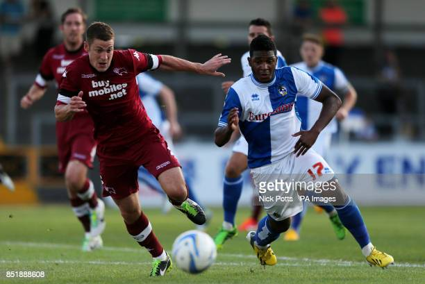 Bristol Rovers' Ellis Harrison tussles for the ball with Derby County's Paul Coutts
