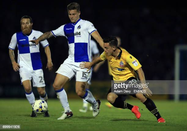 Bristol Rovers' James Clarke and Bolton Wanderers' Zach Clough battle for the ball