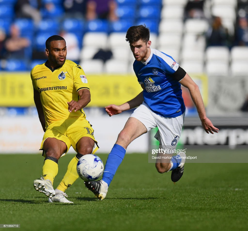Bristol Rovers' Jermaine Easter (L) battles with Peterborough United's Jack Baldwin (R) during the Sky Bet League One match between Peterborough and Bristol Rovers at ABAX Stadium on April 22, 2017 in Peterborough, England.
