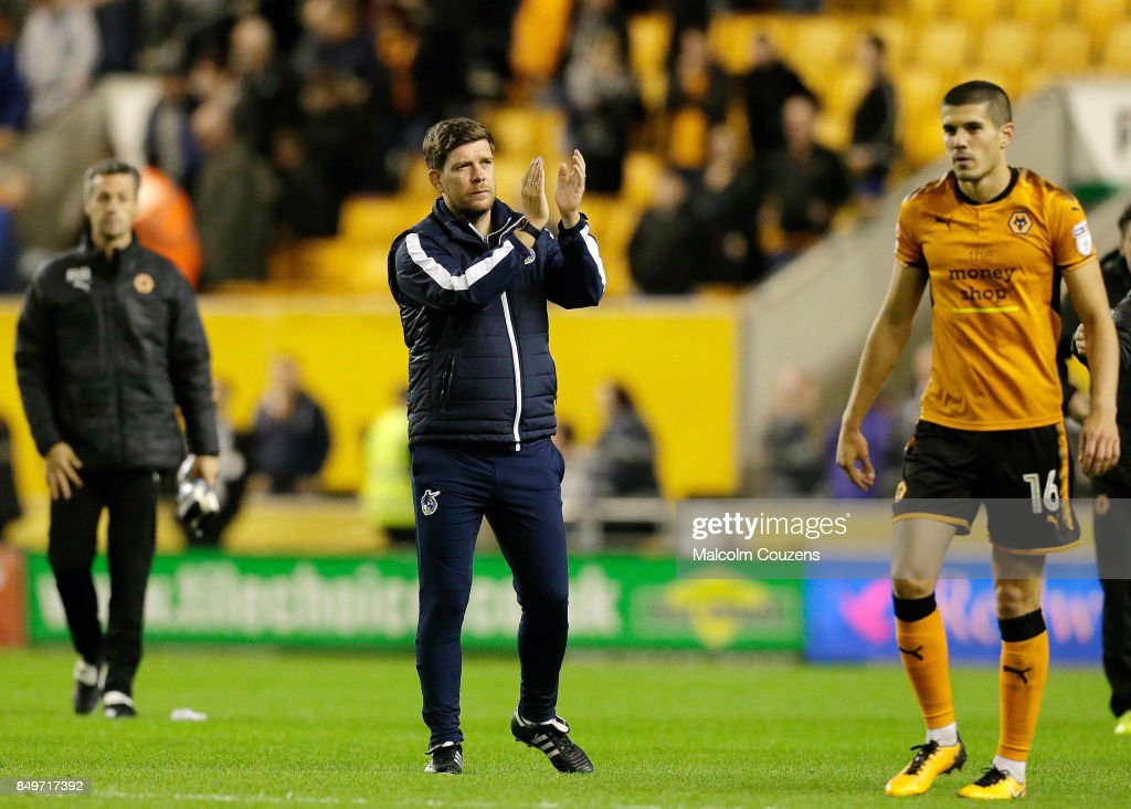 Bristol Rovers manager Darrell Clarke applauds the travelling support following the Carabao Cup tie between Wolverhampton Wanderers and Bristol Rovers at Molineux on September 19, 2017 in Wolverhampton, England.