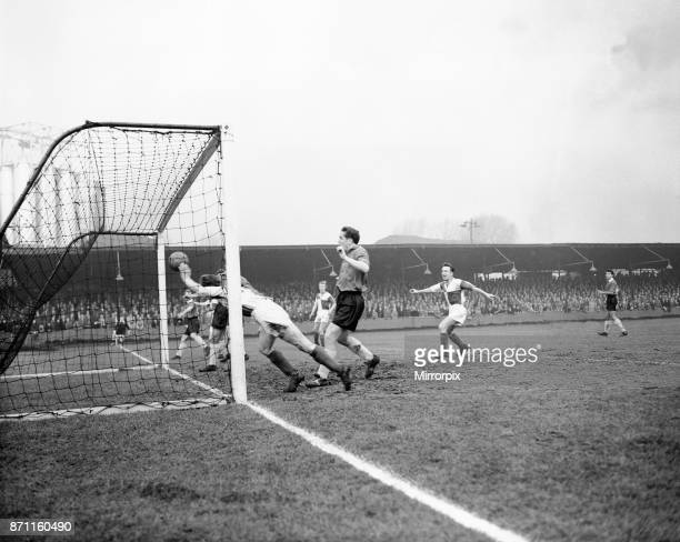 Bristol Rovers v Swansea Town, Division 2. Bristol Rovers forward Ward dives in after the ball, but centre forward Meyer had already made sure of...