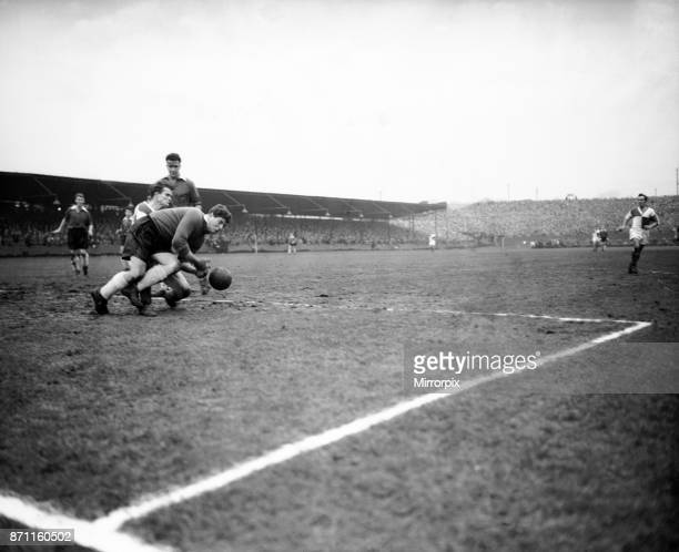 Bristol Rovers v Swansea Town, Division 2. Swansea goalkeeper King collects the ball from Rovers centre forward, Ward, as he rushes in, 26th December...