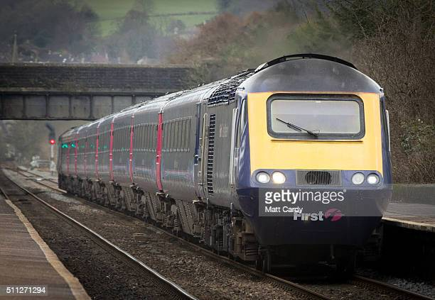 Bristol Temple Meads bound train gathers speed as passes through Oldfield Park as it leaves Bath Spa station on the Great Western railway line on...